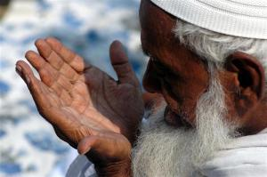 A Muslim man prays during Eid-al-Fitr in the northern Indian city of Allahabad